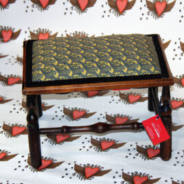 recycled wooden stool covered in bench design fabric, pictured on heart design background