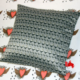 cushion with Boston duck design, silver grey background, studio background graffiti hearts