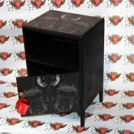 full picture of vintage cabinet covered in French bulldog design with door open, background heart design