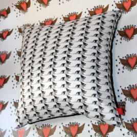 Picture of whole cushion with Collie Dog repeat pattern design, background heart design