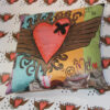 graffiti art with heart with wings cushion on heart design background