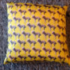 Cushion with a dog pattern with yellow background