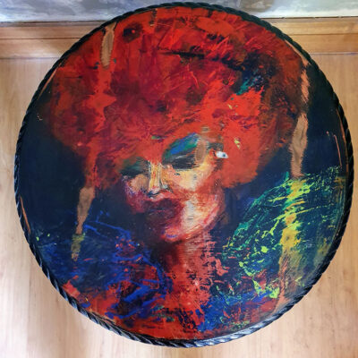 round table top with handprinted drag queen face