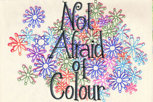 not afraid of colour logo on busy arty background